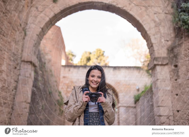 """Pretty woman doing tourism in Granada, Spain Visiting sites near to """"La Alhambra"""" granada tourist pretty 30s 30-35 years people one woman only person women"""