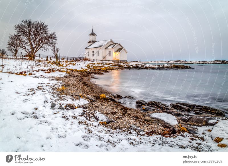 Gimsoy Church on the Lofoten Gimsøy Beach Ocean Bay Snow Winter Lofotes Norway Scandinavia Tree Rock Long exposure Evening blue hour Sky coast Cold