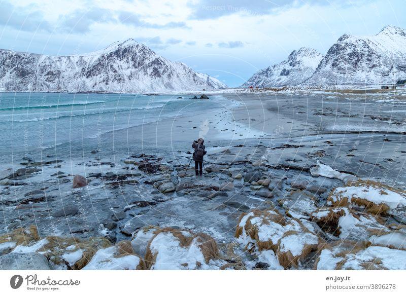 Skagsanden Beach Lofotes Norway Scandinavia Winter Ocean North Sea Rock Landscape Take a photo Photographer Man Snow mountains Ice Frost Exterior shot