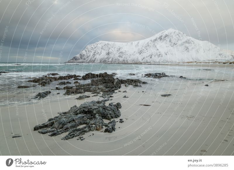 Skagsanden Beach Lofotes Norway Scandinavia Winter Ocean North Sea Rock Landscape Snow mountains Ice Frost Exterior shot Vacation & Travel Nature Mountain Cold