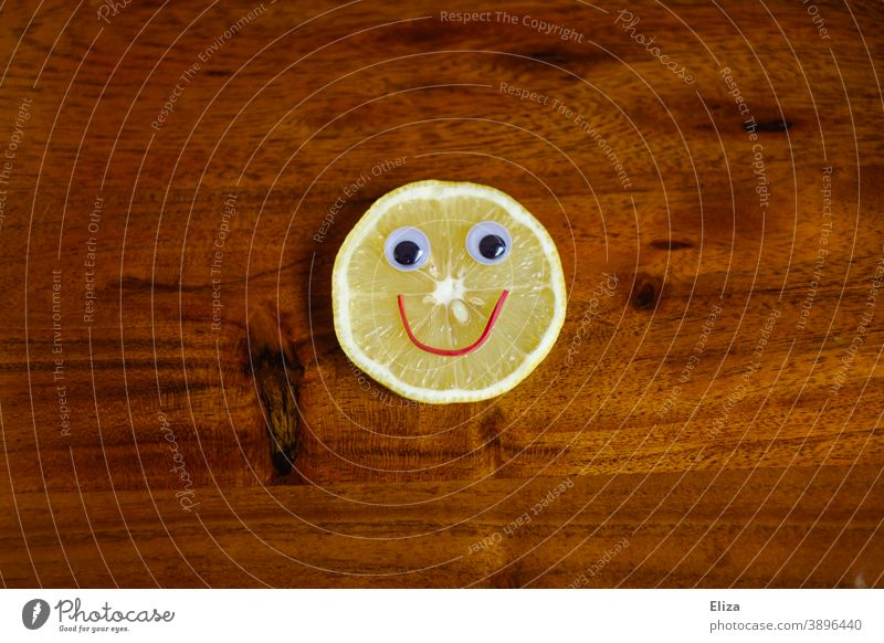 Sauer macht lustig - lemon slice with laughing face on wood Lemon Funny Face Sour cheerful Slice of lemon vitamins salubriously Vitamin C Yellow Food