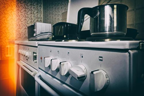 old electric stove saucepan Stove electric cooker Household Kitchen Pot boil blurred background Retro frowzy Switch Buttons adjustment knobs Old