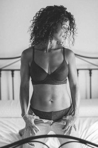 Middle-aged woman posing in bra and jeans lingerie middle-aged 40s white underwear sensuality person lady indoors femininity caucasian body beauty beautiful