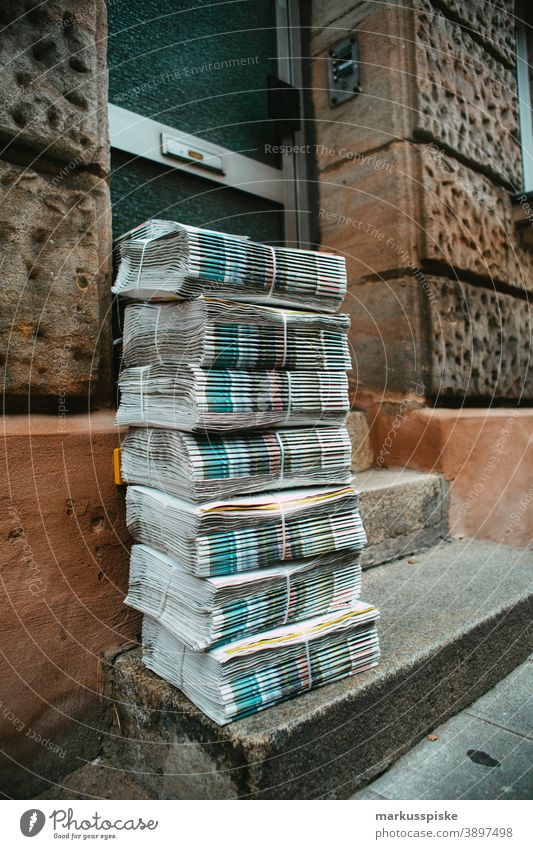 Daily newspaper batch ready for delivery banker Cash dax dollar dow jones finance fonds Hang-Seng hedge fond invest investment management money Nikkei stock