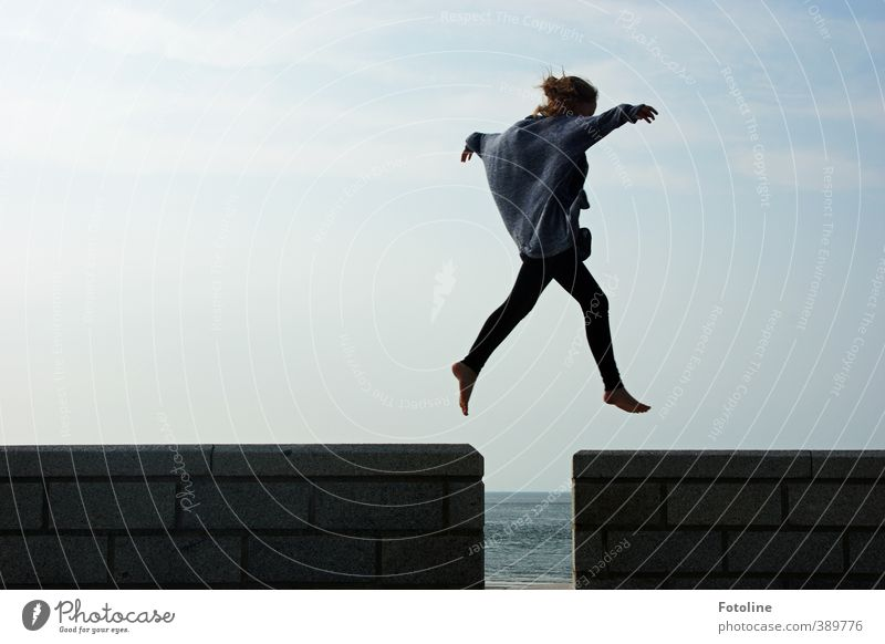 """""""I can fly!"""" cries the girl, spreading her arms and leaping over the gap in the wall Human being Feminine Child Girl Infancy Body Head Arm Hand Fingers Legs"""