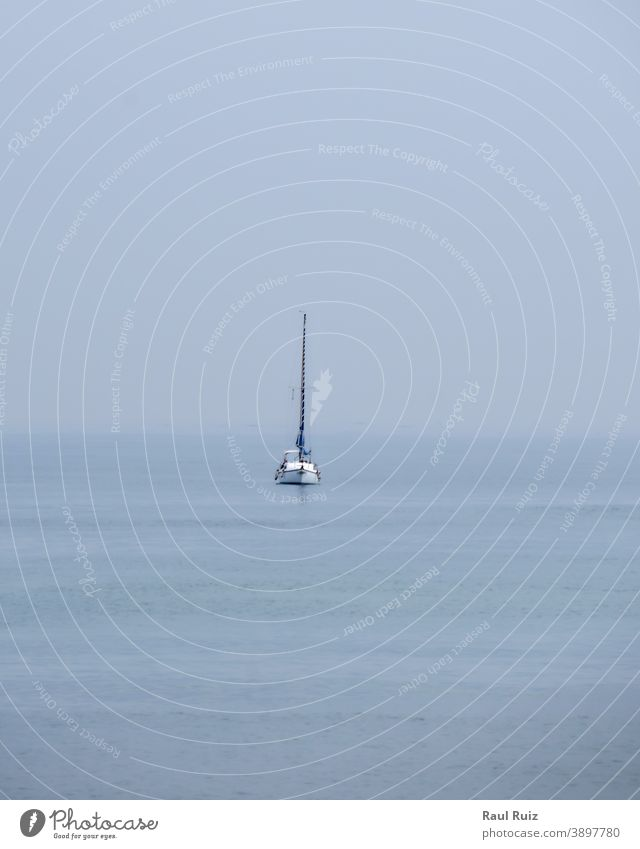 Sailboat in the ocean in cloudy day regatta crew windy sailboat view outdoor vessel holiday competition water adventure blue team beach recreation ship race