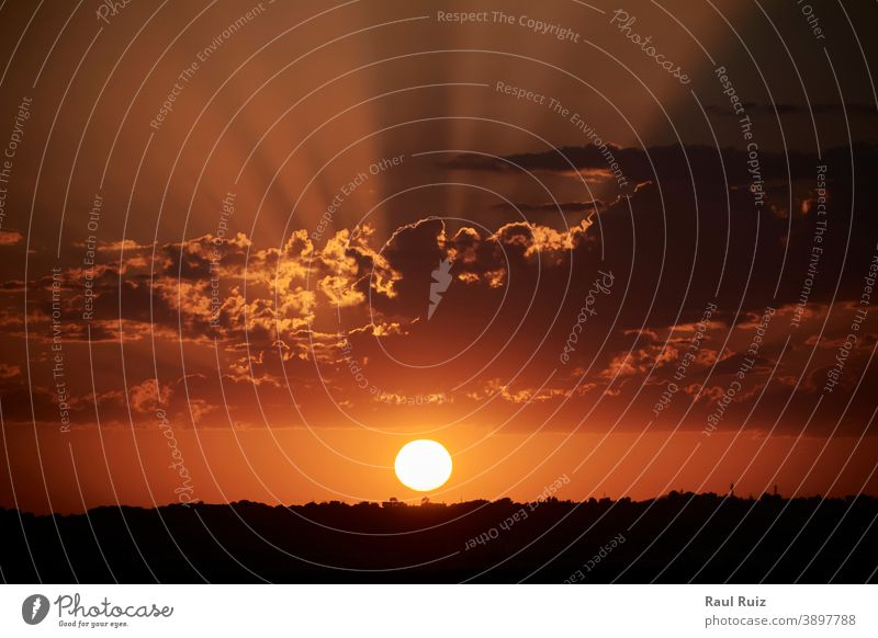 Sunset sun setting behind the horizon cloud day season heaven view solar outdoor idyllic tranquil landscape beauty background cloudscape backdrop meteorology