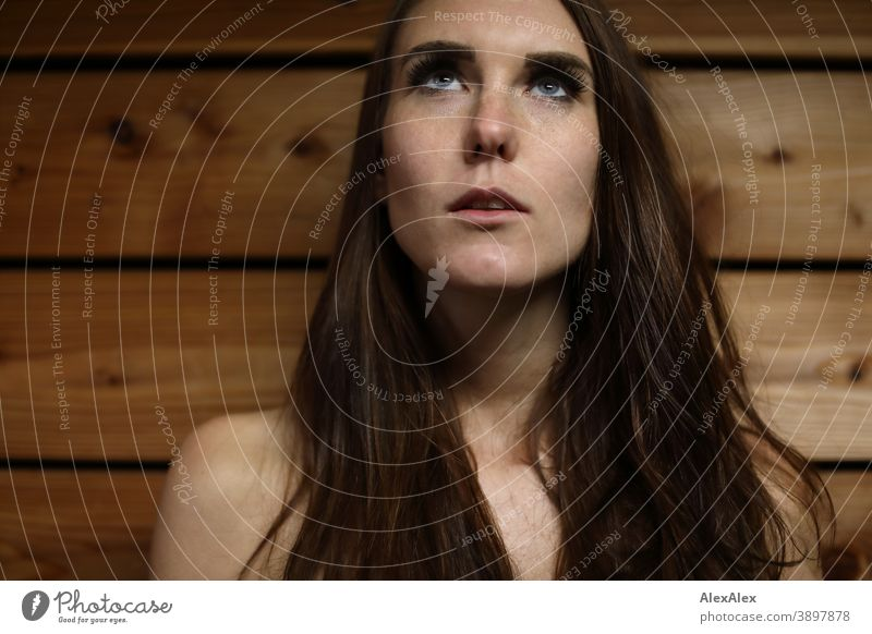 Close portrait of a young woman City lights in front of a wooden wall Woman Young woman Night mood Nahe proximity Light Long-haired Brunette Slim pretty