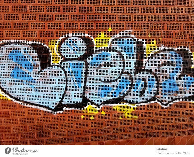 "All that counts - or a graffiti with the word ""love"" sprayed on a brick wall Graffiti Brick Brick wall Brick facade Bricks Colour colored Facade Exterior shot"