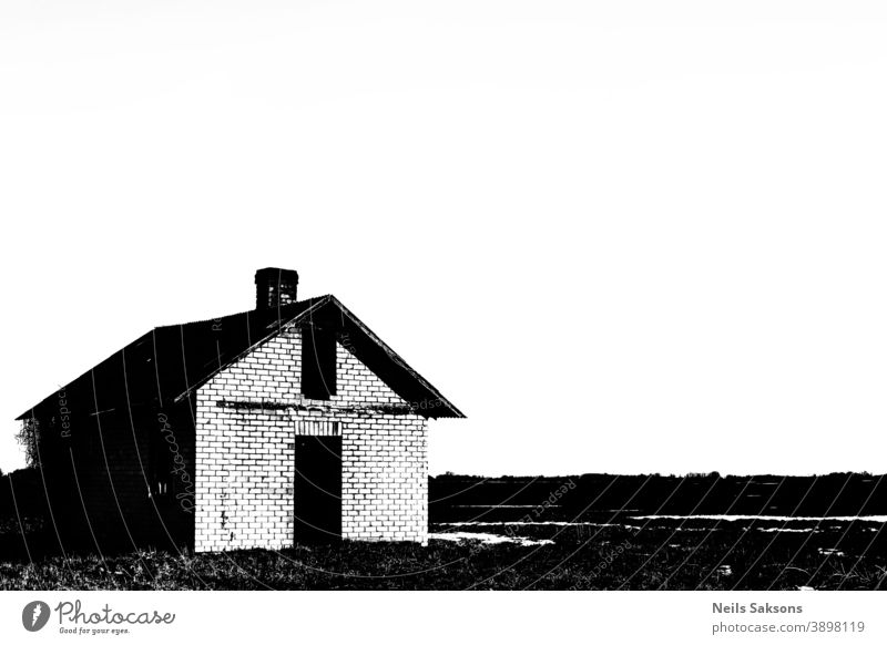 small abandoned house in field, high contrast black and white, copy space Abandoned architecture broken building country countryside day decrepit derelict