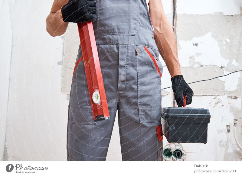 Builder man in uniform with construction tools. Repair concept renovation repair instrument equipment handyman protection builder male worker protective people