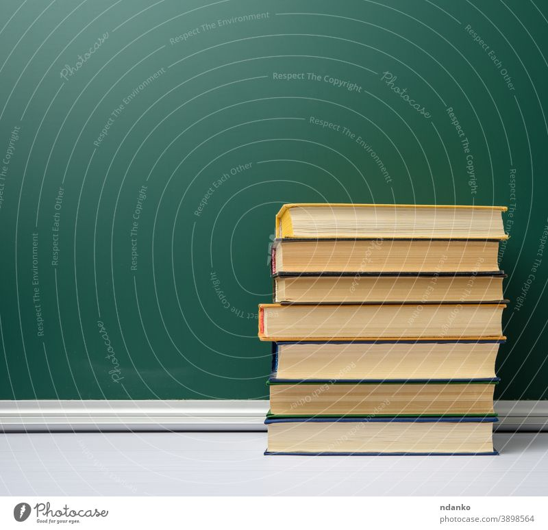 blank green chalk school board and stack of books, back to school bookshop bookstore chalkboard archive background classroom closed collection college cover