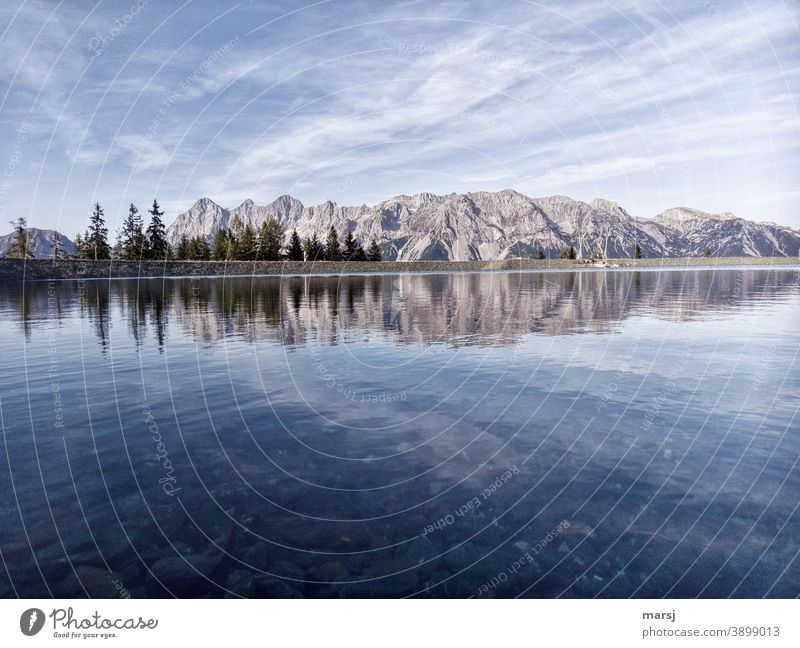 Dachstein massif reflected in a mountain lake reflection Panorama (View) Peak Moody Alps Rock Mitterspitz gate Autumn Clouds Sky Mountain Mountaineering Nature