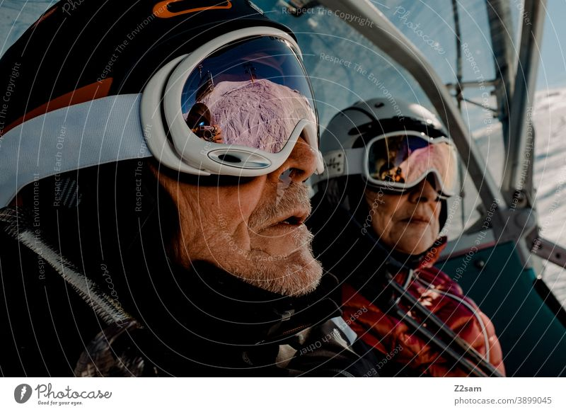 Retired couple skiing in the lift South Tyrol Skiing Winter sports mountains sheep alpine Helm Sports skis Landscape chill Italian vacation Ski piste Ski resort