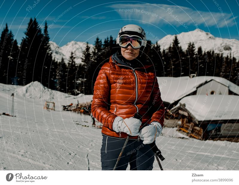 Skier in Ratschings South Tyrol Skiing Winter sports mountains sheep alpine Woman Helm Sports skis Forest Landscape Green Gray chill Italian vacation Ski piste