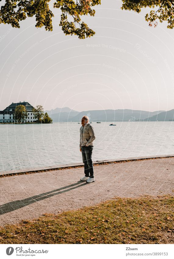 Sporty pensioner in the evening sun at lake Attersee Lake Attersee sunset Evening Sunset Nature Dusk Landscape Idyll Austria Lakeside Exterior shot Smiling