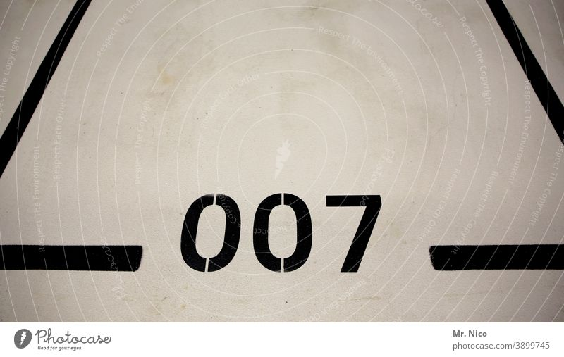 Agent parking lot Digits and numbers Line Black Parking lot Parking garage Signs and labeling Parking level 007 James Bond Boundary Empty Garage