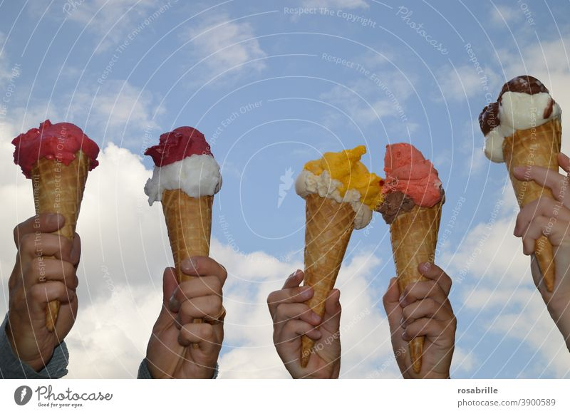 Ice cream balls in a wafer in different flavours and colours | colour combination Ice-cream cone hands lap stop Sky Summer Summery cute variegated