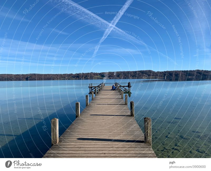 What cross in the sky? Clouds Lake Lake Starnberg Footbridge condensation strips Bavaria vacation Autumn Break To go for a walk bathe be afloat Water
