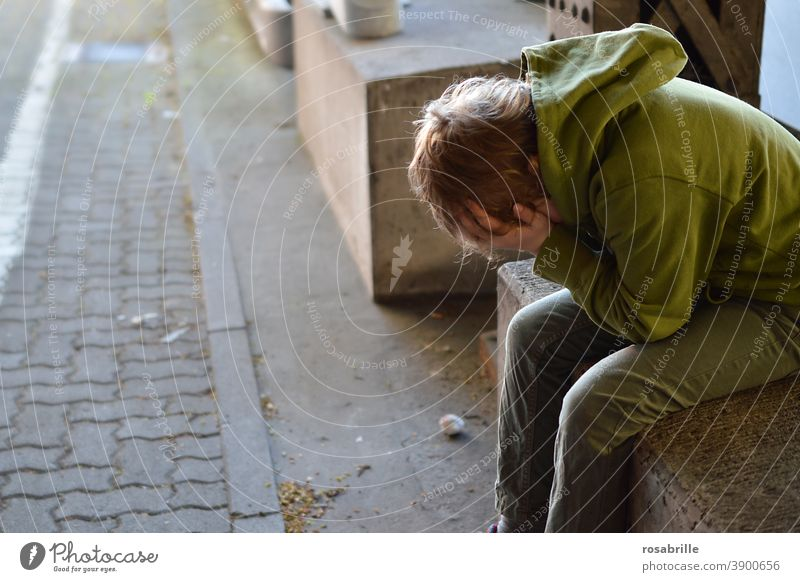 Life breaks | little boy sits desperately crying with his hands in front of his face in an underpass sad Child Boy (child) Cry by oneself Grief Concern Fear