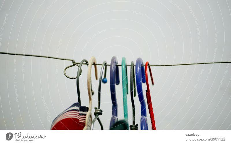 many colors coathanger on coatline Coat Fashion Clothing Lifestyle Style Laundry Clothesline Washing Dry Hang up Clean Household Housekeeping Washing day