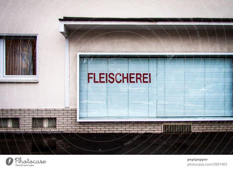 Butcher's shop, shop window with closed shalosiums Butchery Shop window Closed Schalosiums Window Store premises Deserted Exterior shot