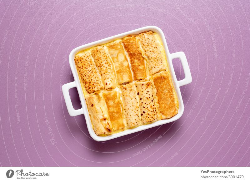 Crepes roll stuffed with cheese and oven-baked, above view background blini breakfast casserole comfort food cooking cottage cheese cream crepes cuisine curd