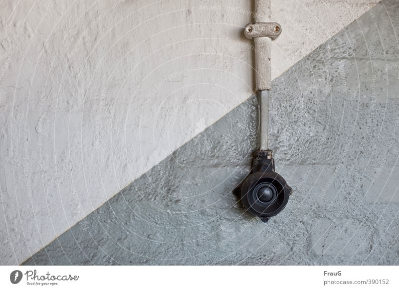 diagonal Cable Energy industry Wall (barrier) Wall (building) Bell Plastic Old Gray Black hose clip Dye Diagonal bakelite Colour photo Interior shot Deserted