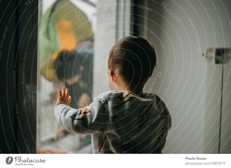 Child watching Mother through the window childhood Toddler Caucasian Rear view through window caucasian Day Family & Relations Human being kid 1 - 3 years