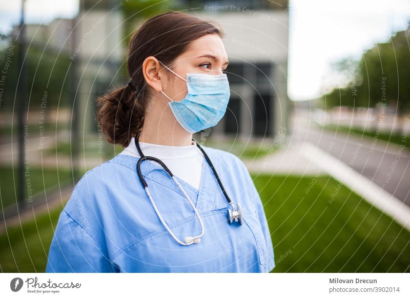 Serious female caucasian doctor looking away with worried facial expression,lost hope due to high mortality rate death toll,Coronavirus COVID-19 pandemic crisis,overworked exhausted EMS staff portrait