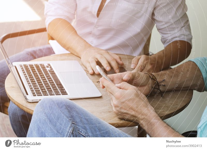 Two businessman meeting and using smartphone with laptop at outdoor cafe gadget wifi hipster young internet social web connection network hand media concept
