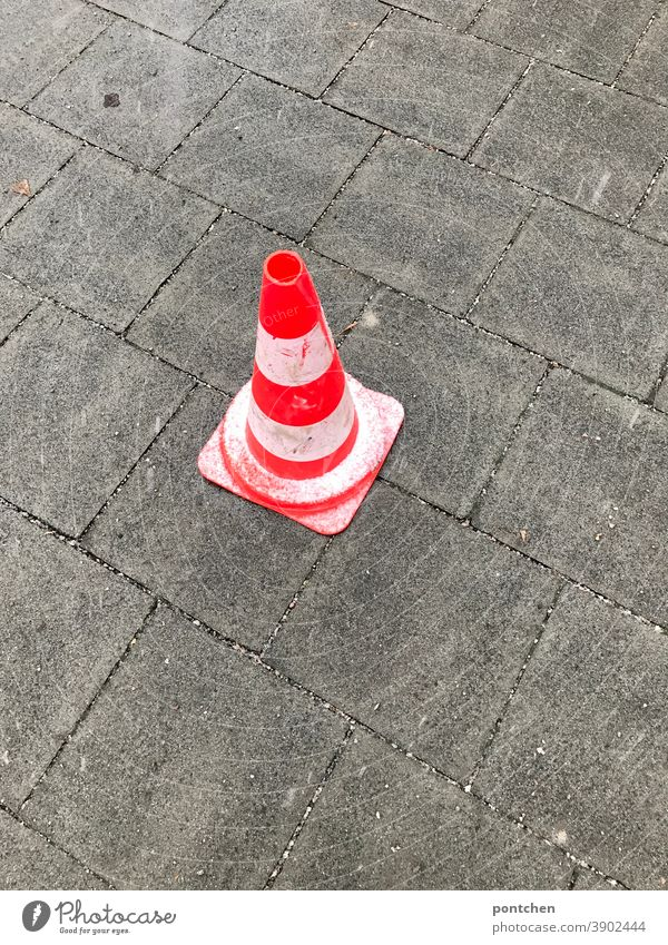 Accident. A warning traffic cone is on wet ground. traffic cone, traffic cone, pylons, traffic cone. Traffic cone Transport traffic cones Warn peril blocking