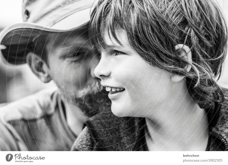 twosome Joy Safety Contentment Infancy Exterior shot Hope proximity Affection Contrast Father Parents Family & Relations Together Trust portrait Detail Light