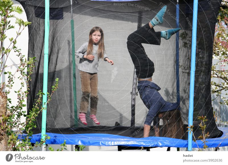 Trampolinists air jump blonde child fun girl high hop joy laughter leisure Trampoline young