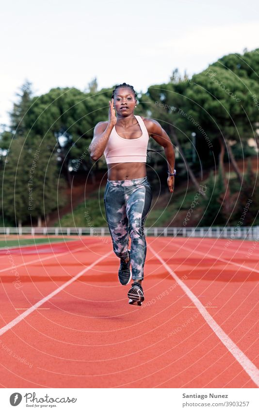 Athlete sprinter running control race competition athlete athletics competitive ready line beginnings compete competitor olympic olympics sports women african