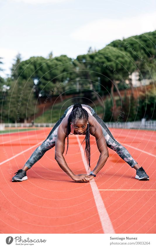 Athlete sprinter stretching her legs control race run competition athlete athletics competitive ready line beginnings compete competitor olympic olympics sports