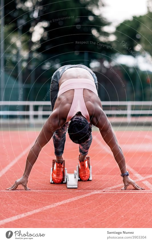 Athlete sprinter in starting position race competition athlete athletics competitive ready line beginnings compete competitor olympic olympics run sports women