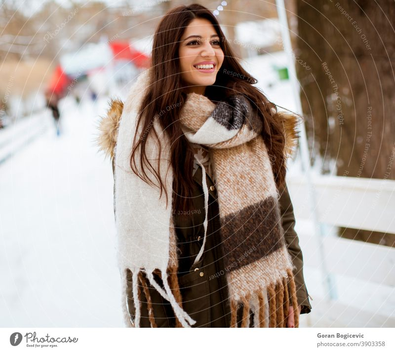 Young woman in winter park adult attractive beautiful beauty casual caucasian christmas cold cool face fashion female frost fun girl happiness happy hat holiday
