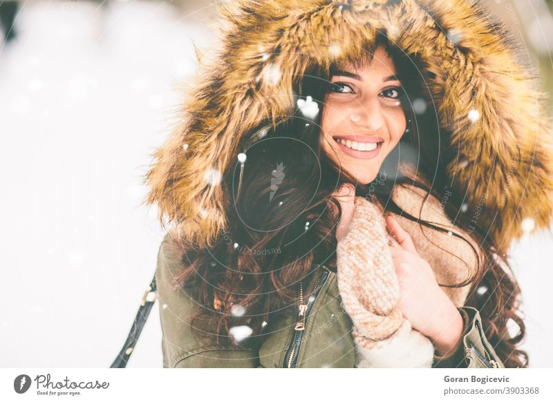 Young woman with fur hood in the park on the snow pretty Close-up garments Coat Cold Fashion Woman Pelt Girl Happy Hooded (clothing) Jacket Nature Outdoors Park