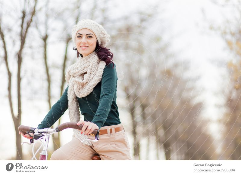 Young woman on the bicycle active adult beautiful beauty bike biking casual countryside cute cycling fashion female field free freedom fun girl leisure