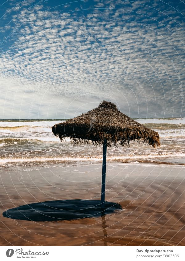Lonely straw umbrella on seashore beach summer protect blue sky paradise sand exotic vacation travel nature tourism idyllic seaside coast resort tropical ocean