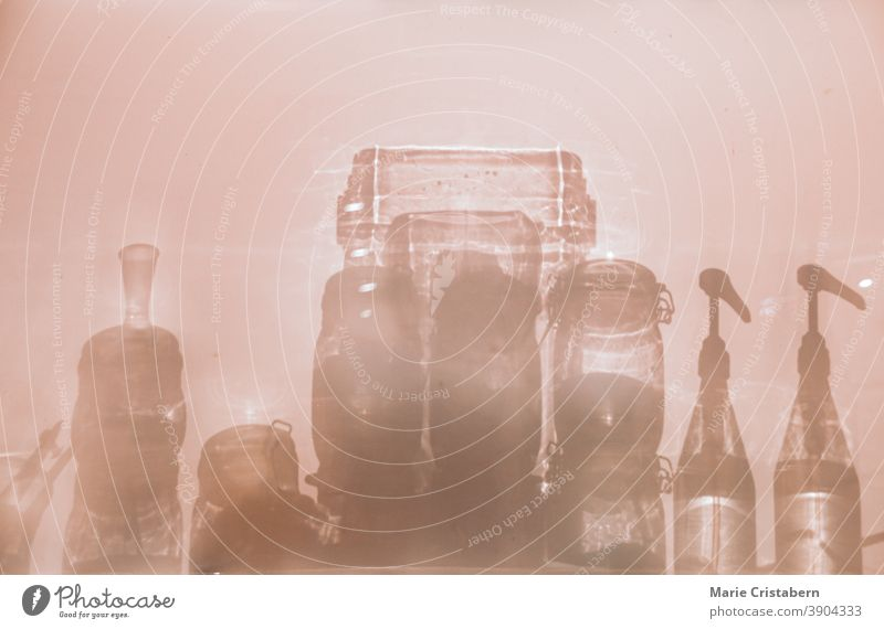 Conceptual photo showing the silhouettes of glass bottle containers to show concept of sanitation, infection control and good hygiene to fight the spread of covid-19 pandemic