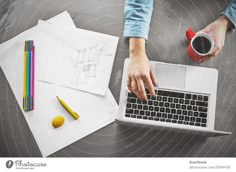 Top view of architect woman working at computer in office laptop business workplace hands breakfast keyboard desk table technology notebook coffee up writing