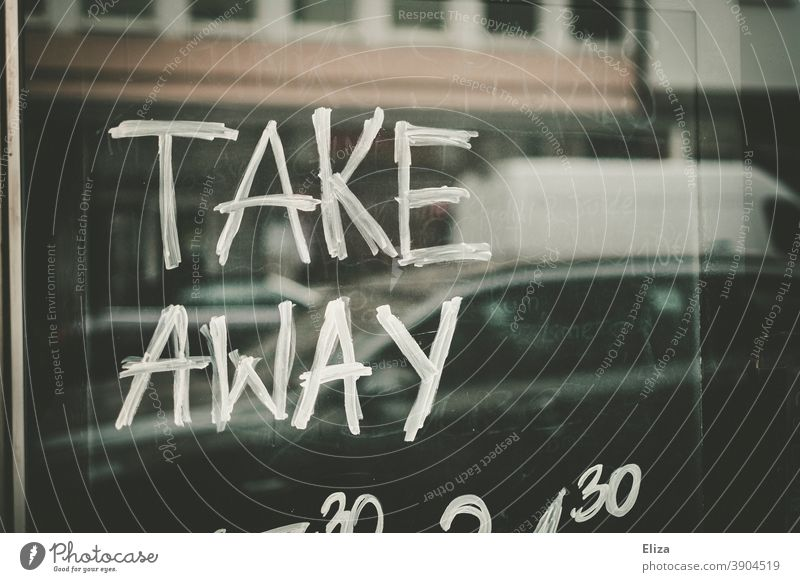 Take Away is written on a sign of a restaurant that is closed because of the Corona Lockdown take away out to go Restaurant corona lockdown Gastronomy authored