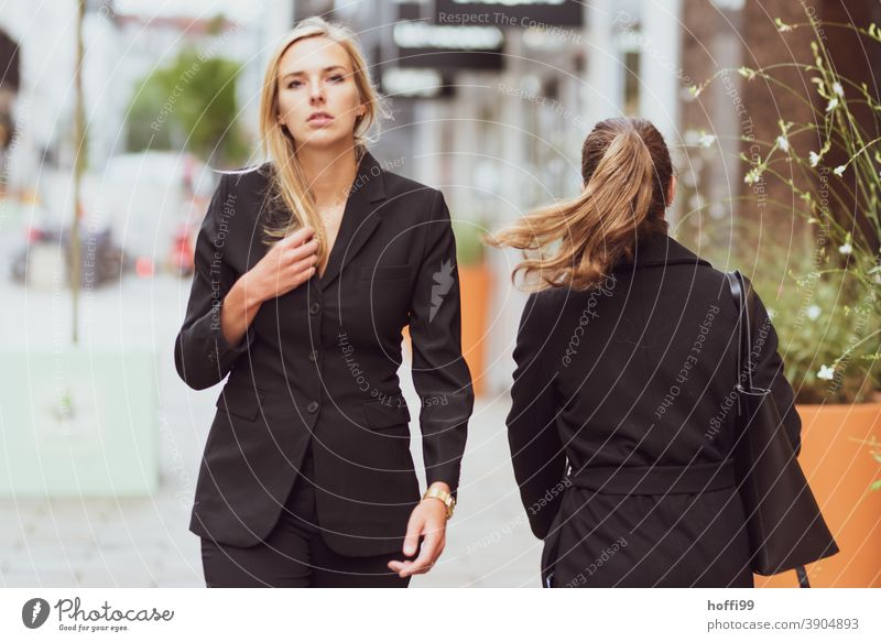 the young woman walks and looks confidently into the camera Young woman Career Success smiling woman Lifestyle Fashion Elegant Face of a woman