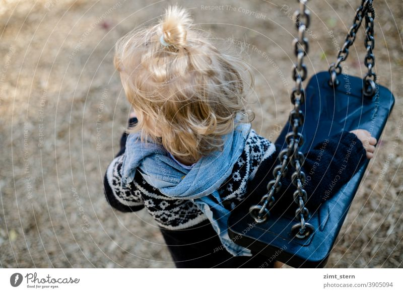 Child with swing on the playground Playground Swing Introverted Waldorf children's clothing Infancy Playing Lonely sad by oneself contented Observe