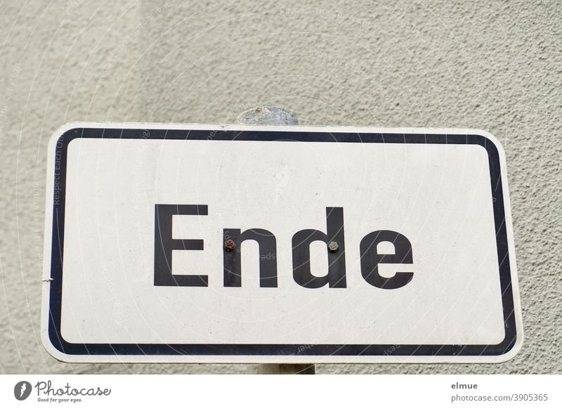 "the white, framed metal sign reads ""End"" in black block letters / conclusion ending metal plate Target Completed Communication beginning of the end Prelude"