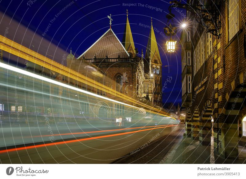 Traffic in Bremen City hall Transport Tram Movement Illuminated Night shot Brick Gothic Sightseeing light track Long exposure vacation travel Tourist Attraction