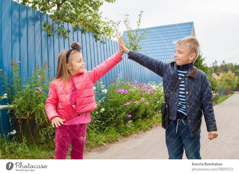 high five. Happy children greet each other outdooes. Image with selective focus nature person boy smiling emotion holiday vacation sunny lifestyle healthy