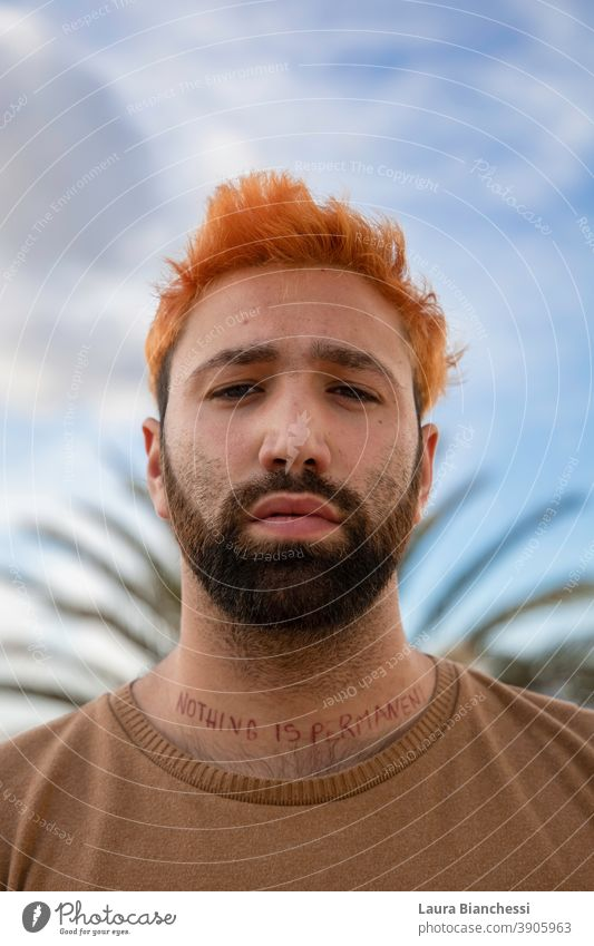 Portrait of young man crowned by leaves with beard, orange hair and tattooed neck nothing is permanent Tattooed Neck Beard bearded Orange Hair